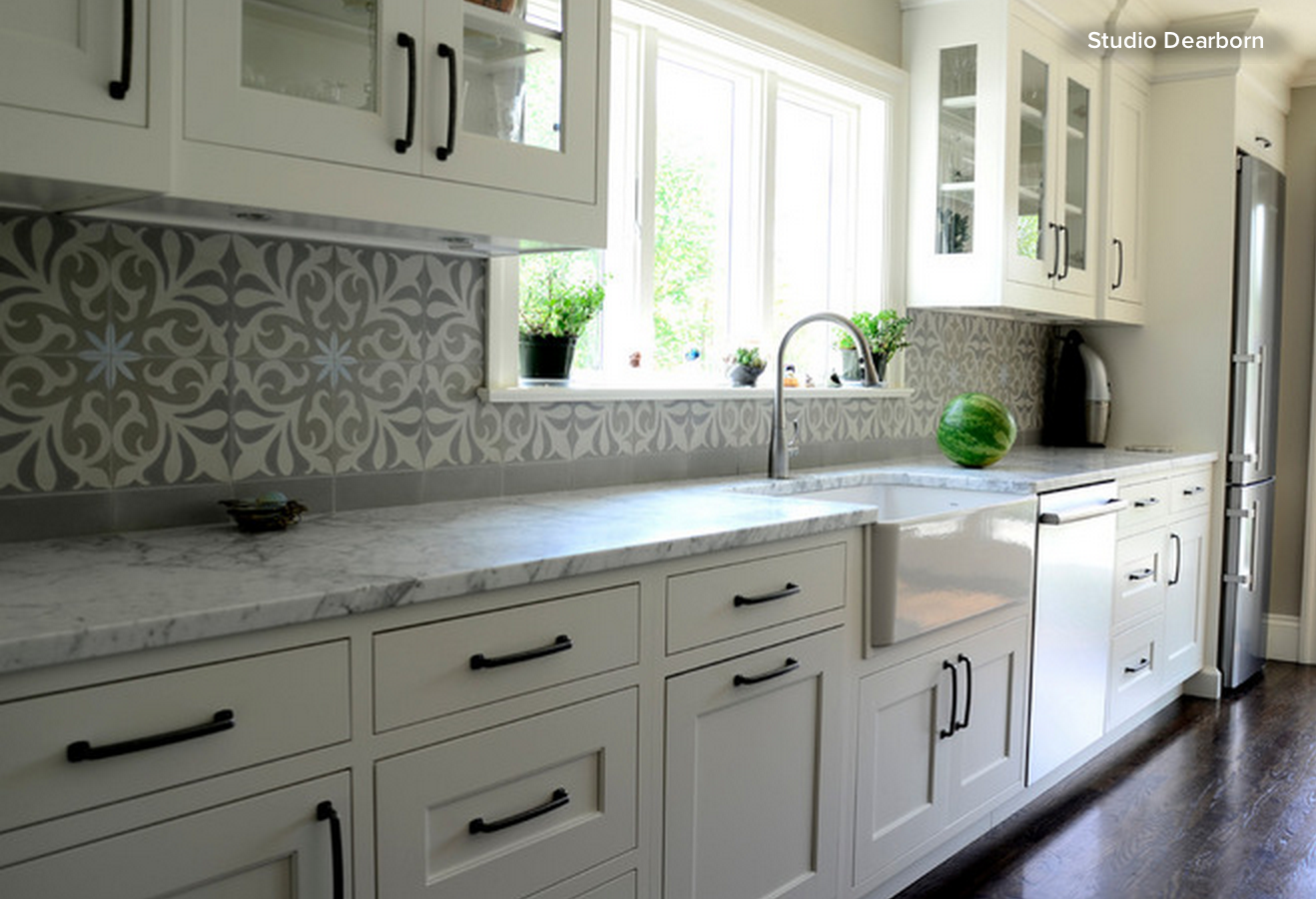 Get the cement tile look a cement tile backsplash adds pizzazz in but the key element tying together the grey stained island and the marble countertop to the rest of the space why that cement tile backsplash of course doublecrazyfo Choice Image