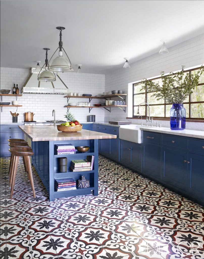 The White Wall Tiles And Red Element Adds A Beautiful Contrast With Blue Traditional Patterned Tile Design Also Helps To Keep This Kitchen
