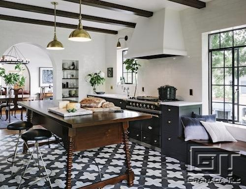 Badajoz cement tile grounds this industrial antique kitchen designed by Jessica Helgerson