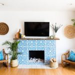 Granada Tile's Alhambra cement tiles cover a fireplace in a home seen on Apartment Therapy