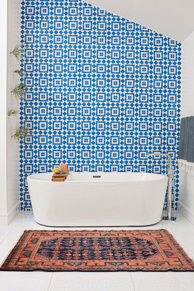 A wall of Granada Tile's Fez cement tiles make a strong statement in a modern bathroom