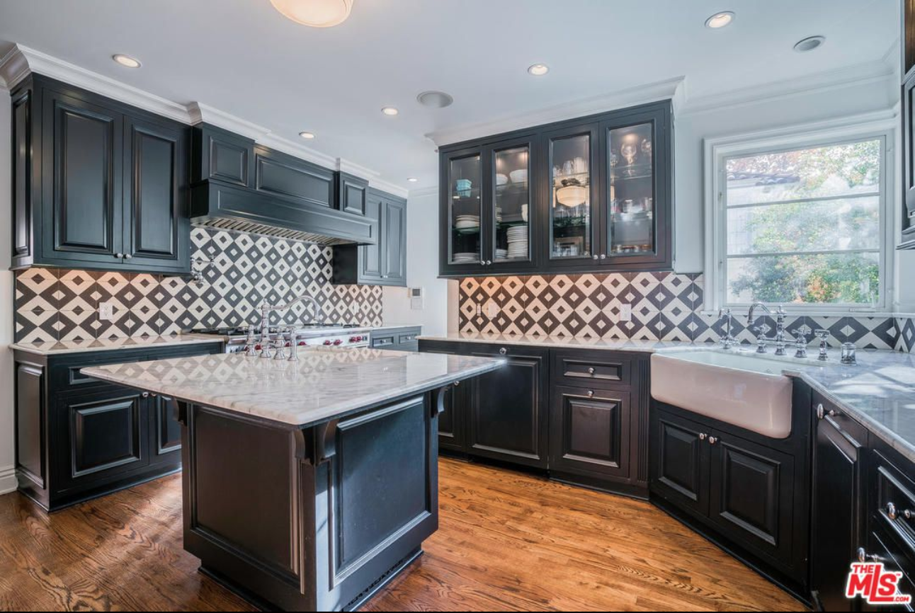 Granada Tile's Serengeti cement tiles brighten a kitchen