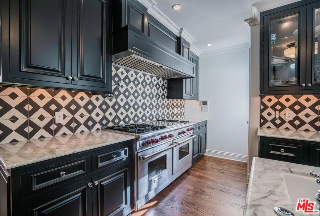 Granada Tile's Serengeti cement tiles brighten a kitchen