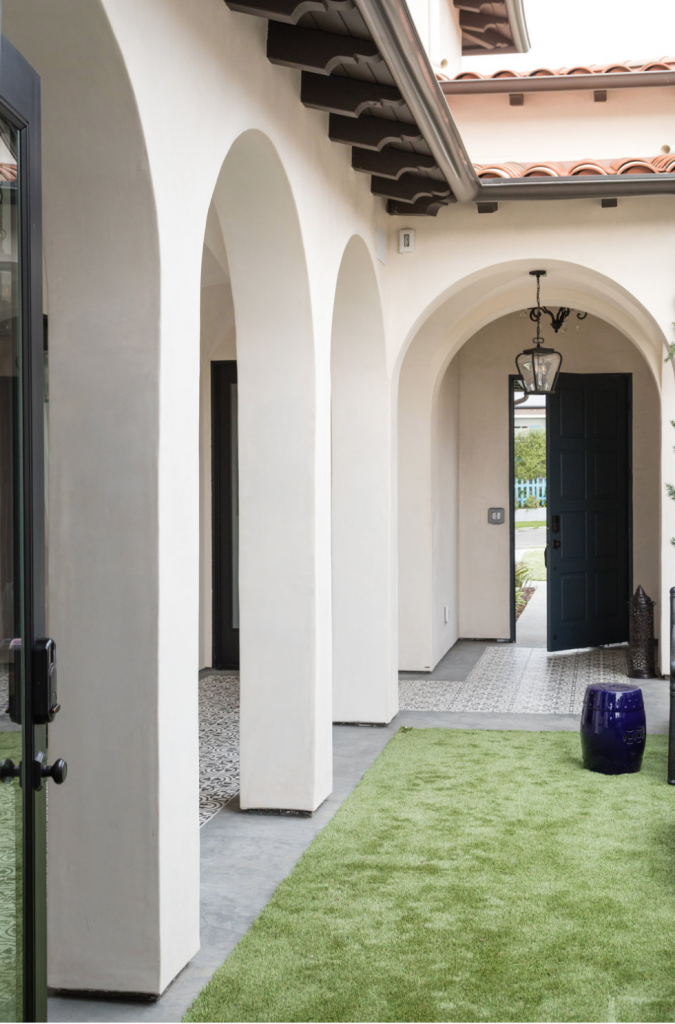 Cluny cement tiles in in-stock black and white encircle the courtyard of a Denton Developments project