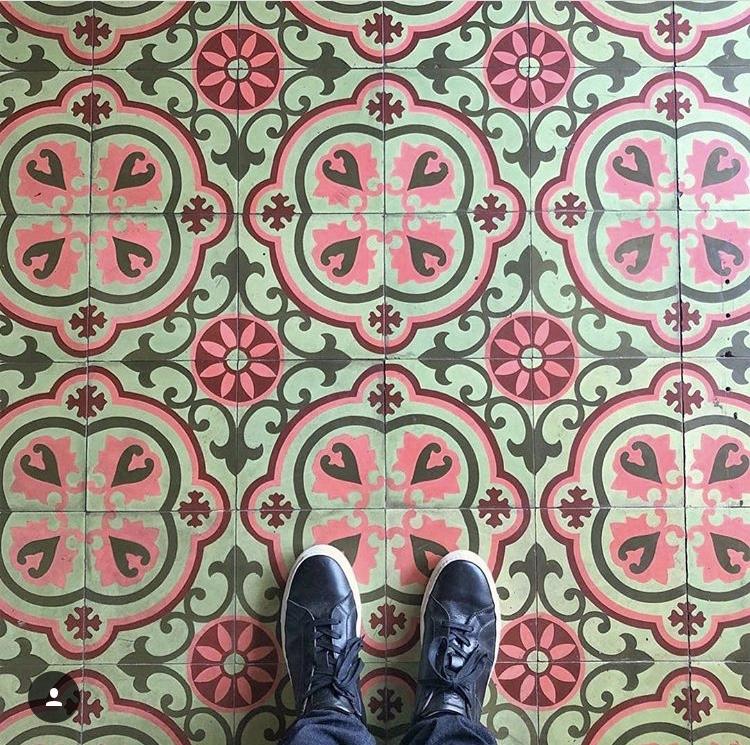 Custom-colored Copenhagen cement tiles by Granada Tiles at Dama Fashion District by Carolina Wicker Designs