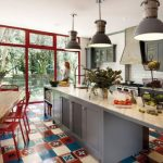 A kitchen with a patchwork tile design