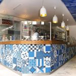 Blue, black, and white patchwork tile design in a Greek Yogurt business