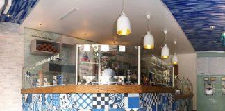 Blue, black, and white patchwork tile design in a Greek Yogurt business