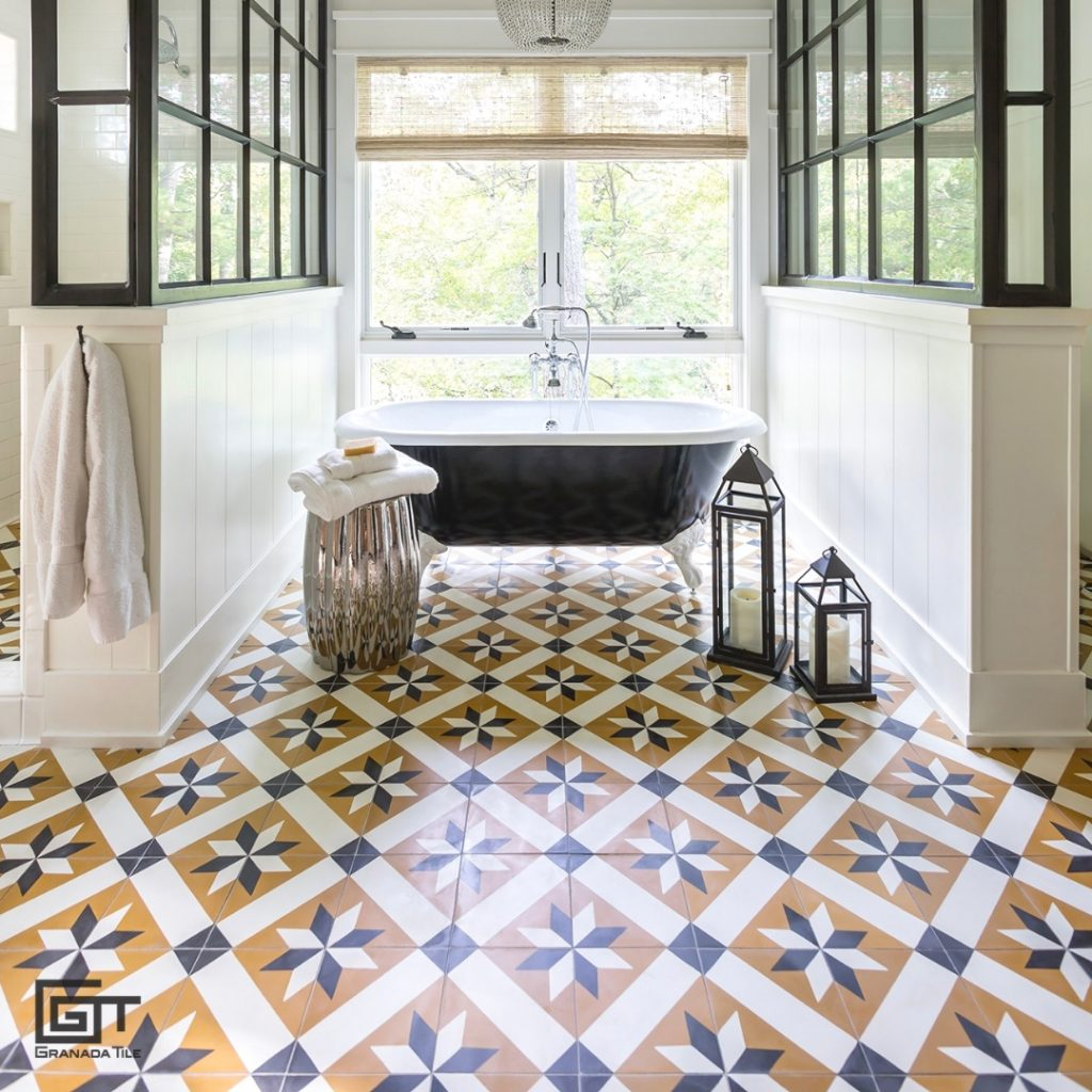 A bathroom with a bathtub, window, and Toscano pattern tiles