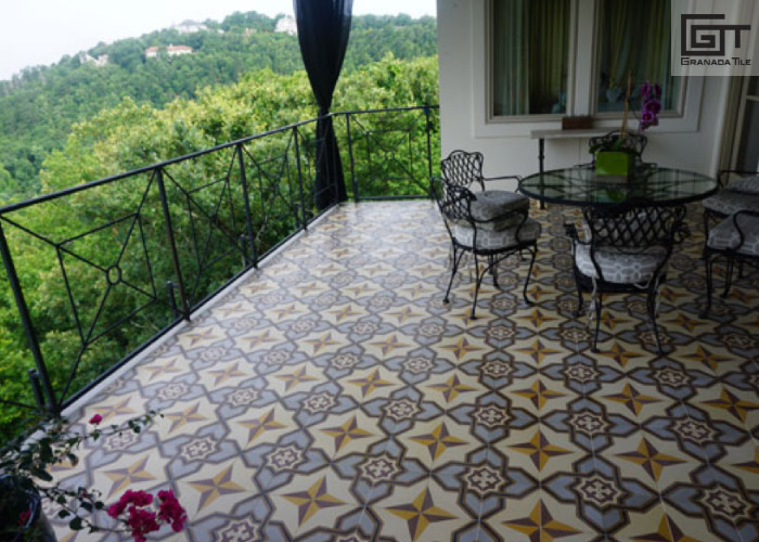 A Covered Balcony With Encaustic Tiled Flooring A Table And 3