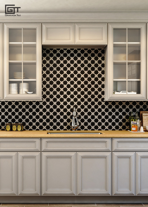 A kitchen with star and cross cement tiles on the wall