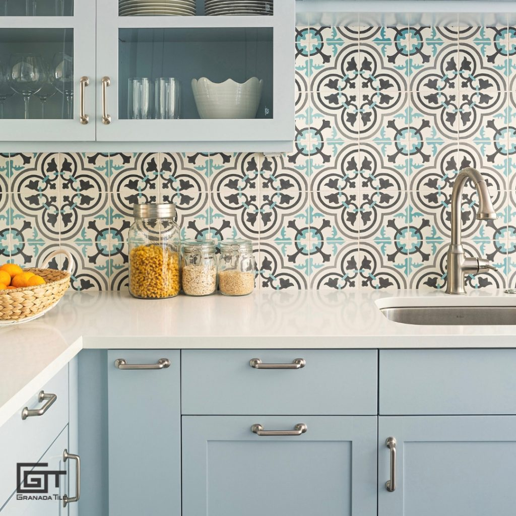 Cluny Cement Tile highlights the cabinetry in a pale blue kitchen
