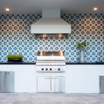 Outdoor kitchen with cement tile wall