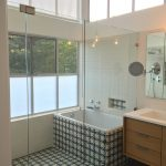 A bathtub area covered with Athens pattern from Granada Tile
