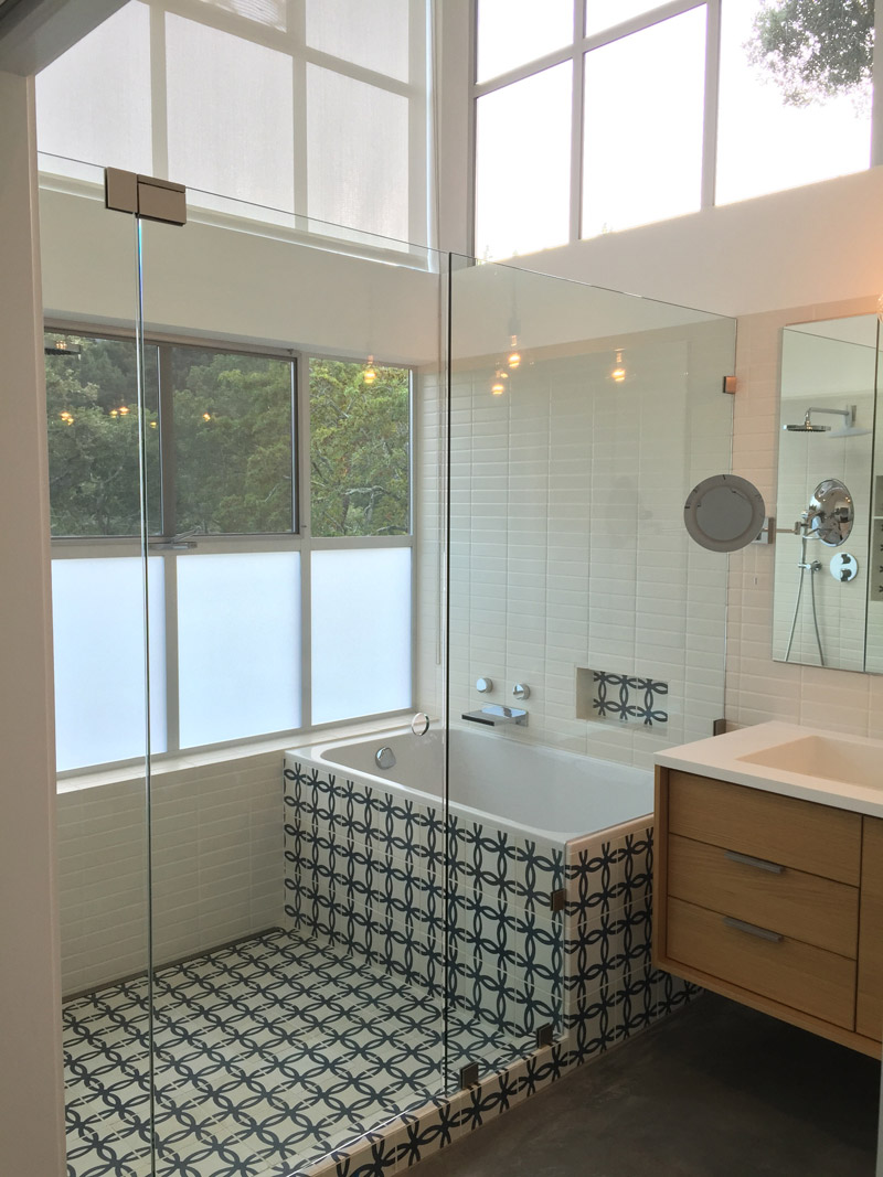 A bathroom with cement tiles from Granada Tile's Echo Collection