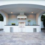 Granada Tile's Calais pattern installed across an outdoor patio wall
