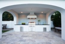 Granada Tile's Calais pattern installed across an outdoor patio wall