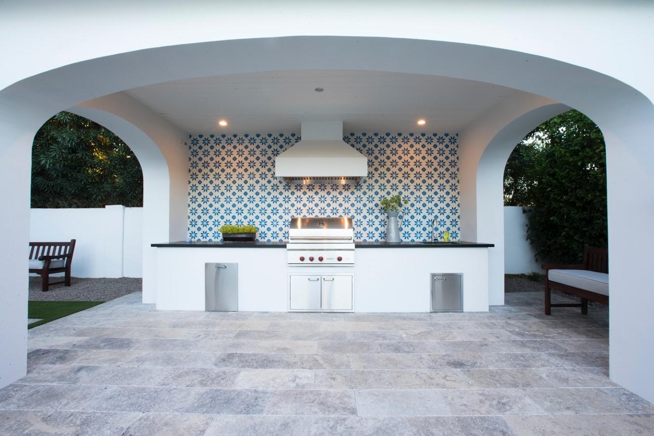 Designer Paul Schatz uses Granada Tile's cement tile pattern, Flor, to create a classic and elegant bathroom design