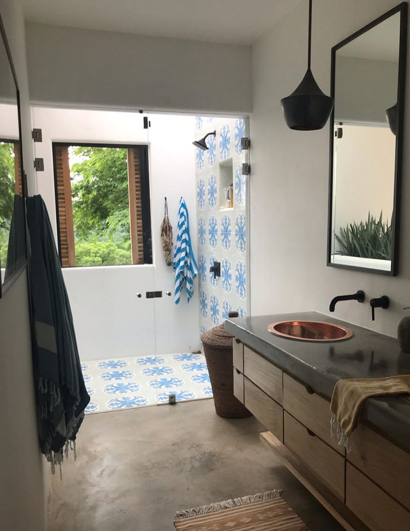 cement flooring by lining the shower with vibrant Napoli 51 A cement tiles