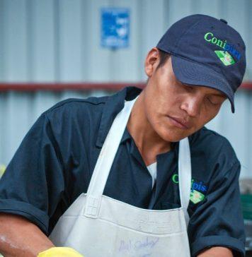 A man cleaning a concrete tile