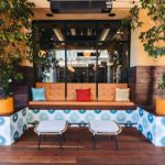 Kotka tile design along the low walls in an outdoor seating area