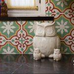 A Sofia pattern used as a kitchen backsplash with owls near it