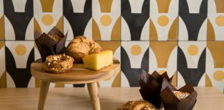 Granada Tile's Stockholm pattern on the wall next to baked goods on a table