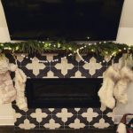 A Christmas fireplace using Badajoz tiles made by The Wardrobe House