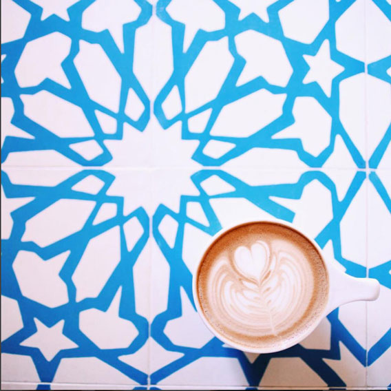 Cappuccino cup on top of intricate Alhambra cement tile by Granada Tile