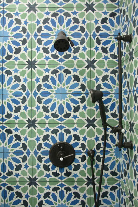 Shower covered in Alhambra tile in blues and greens