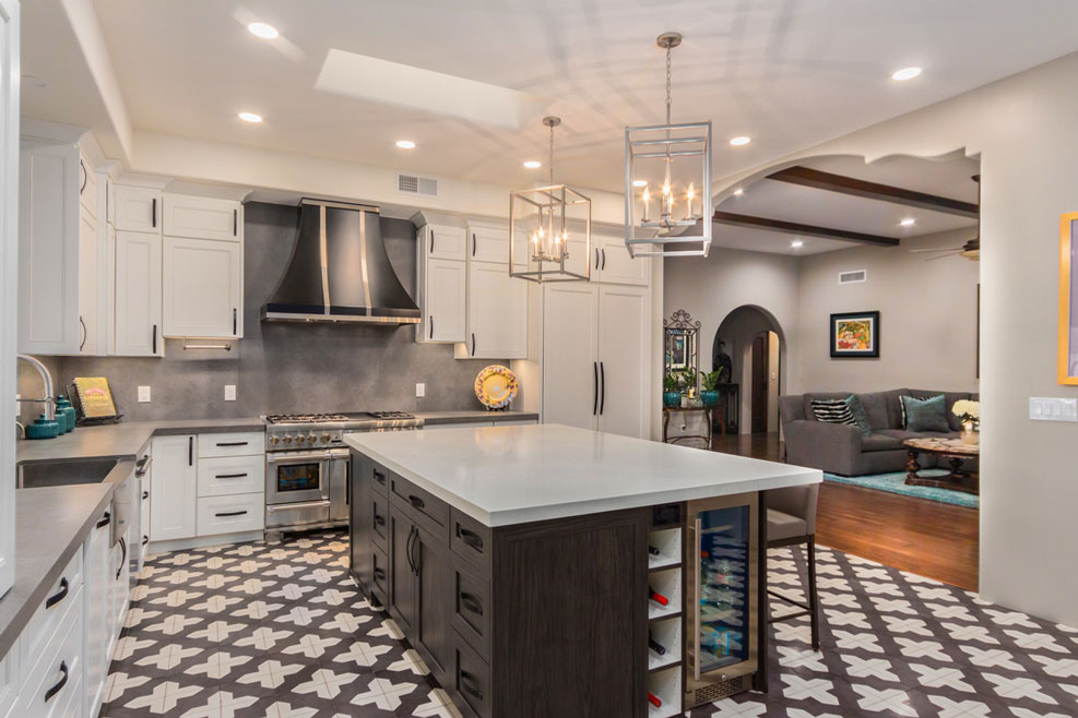 Big open kitchen with island tiled in black and white patterned cement tiles