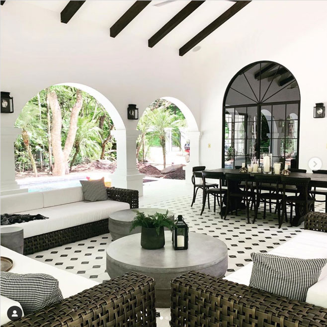 High ceilinged open patio space tiled with a simple black and white geometric tile design by Granada Tile