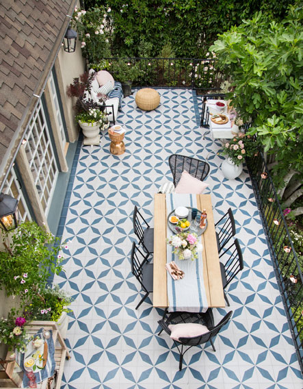 Designer Emily Henderson created an elegant patio with Granada Tile's Buniel Cement Tile in midnight and hawk.