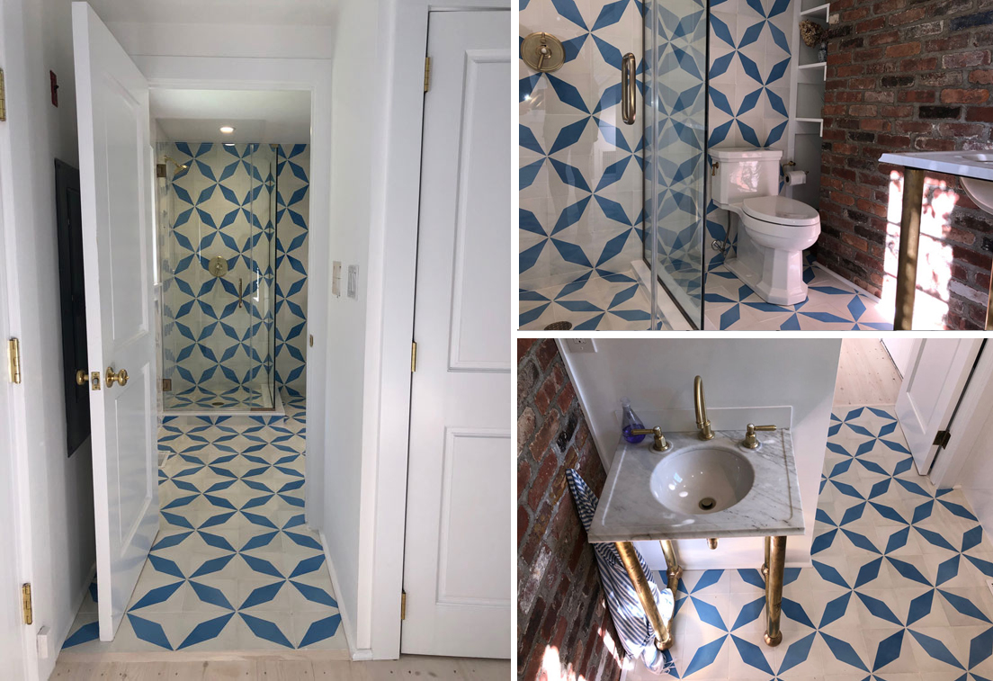Cement tiles with diamond patterns cover the floor and wall of this bathroom