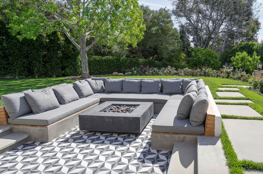 Tiled seating area featuring Granada Tile's geometric tiles in grand garden