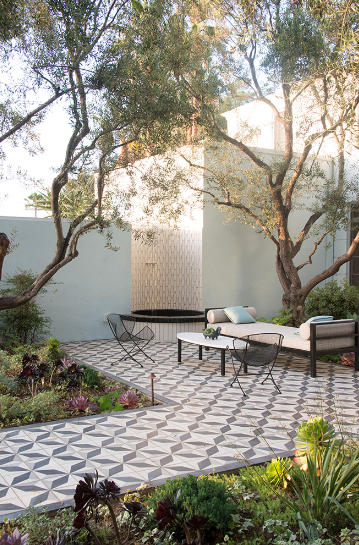 Peaceful patio paved with geometric Granada Tile's Burgos Cement Tiles