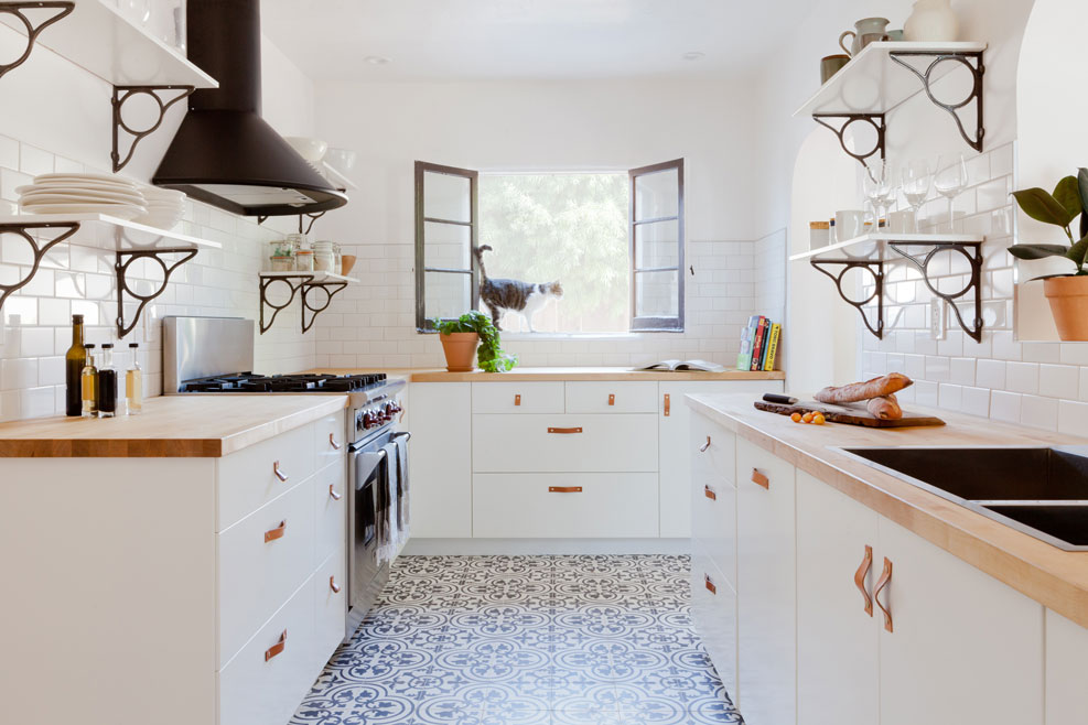 Airy kitchen with black and white cement tiles on floor