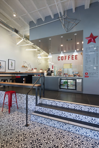 Granada Tile's classic black and white Cluny cement tile livens hip Modern Cafe in Oakland California.