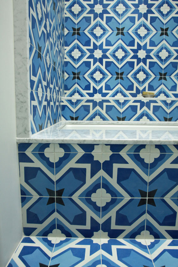 Bathroom covered in star patterned Corsica tile