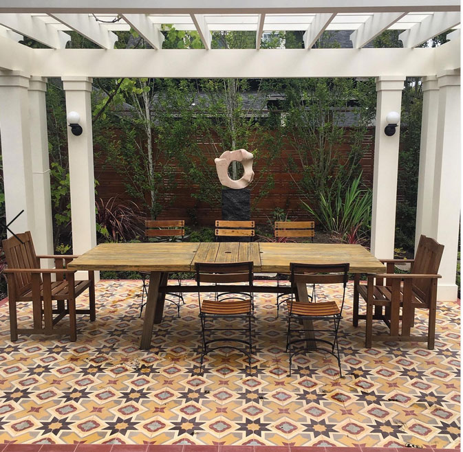 Colorful cement tiles grace a backyard designed by BlossomPortland