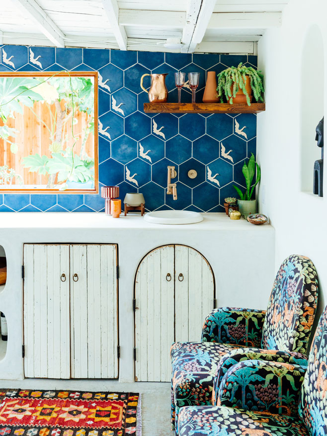 Colorful casita kitchen with large backsplash of custom hexagon tiles