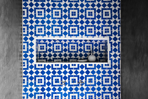 Fez-Patterned Cement Tile Shower Wall with Fez-Filled Niche at Boutique Hotel