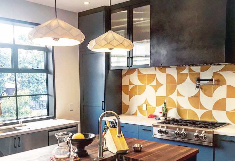 Playful backsplash with mustard and white tiles