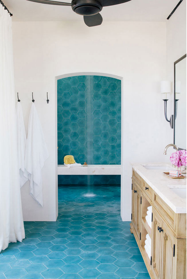 Turquoise colored cement tiles define a spa-like bathroom