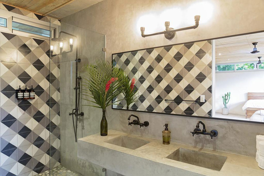 Tiles create the effect of a woven pattern on a bathroom wall