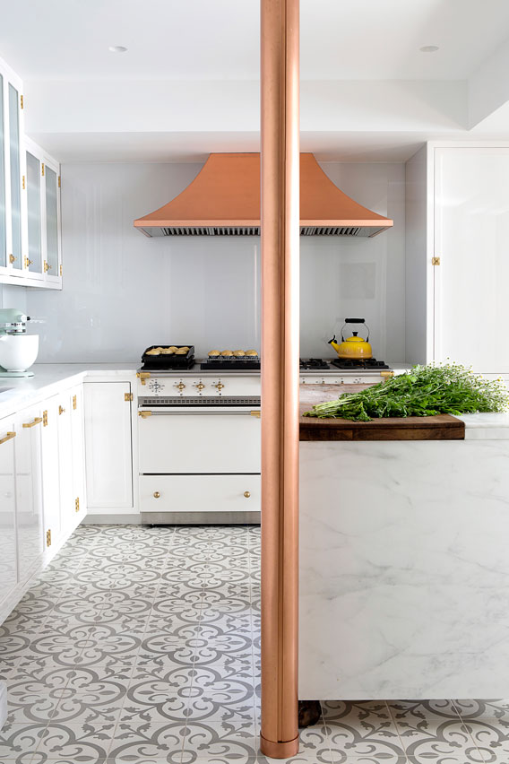 Chic kitchen in white and grey with accents of copper