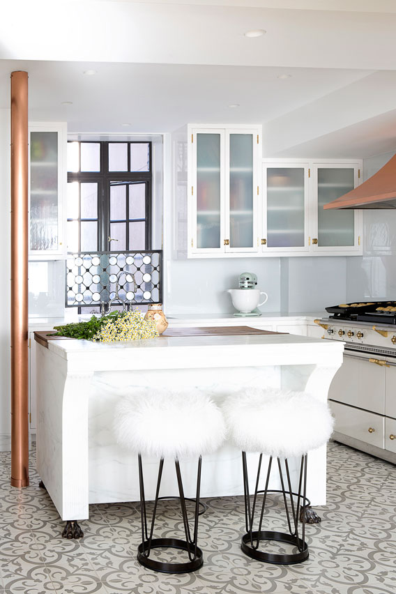 Chic black, white and grey kitchen with copper accents and cement tile floor
