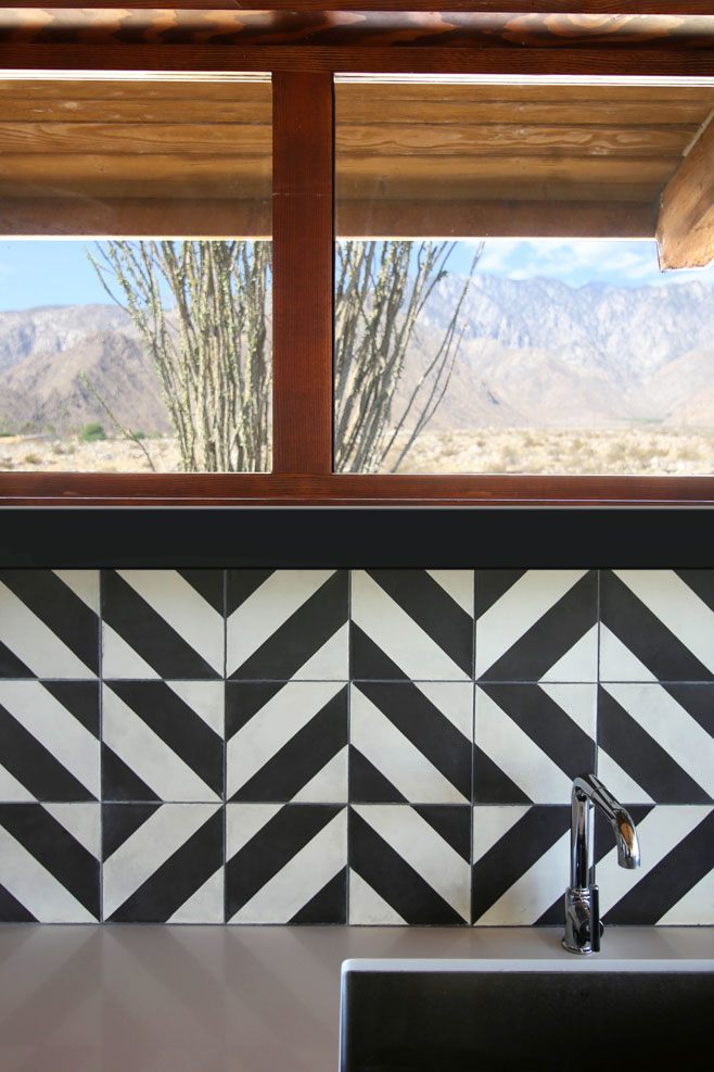 Close up of kitchen backsplash with desert view