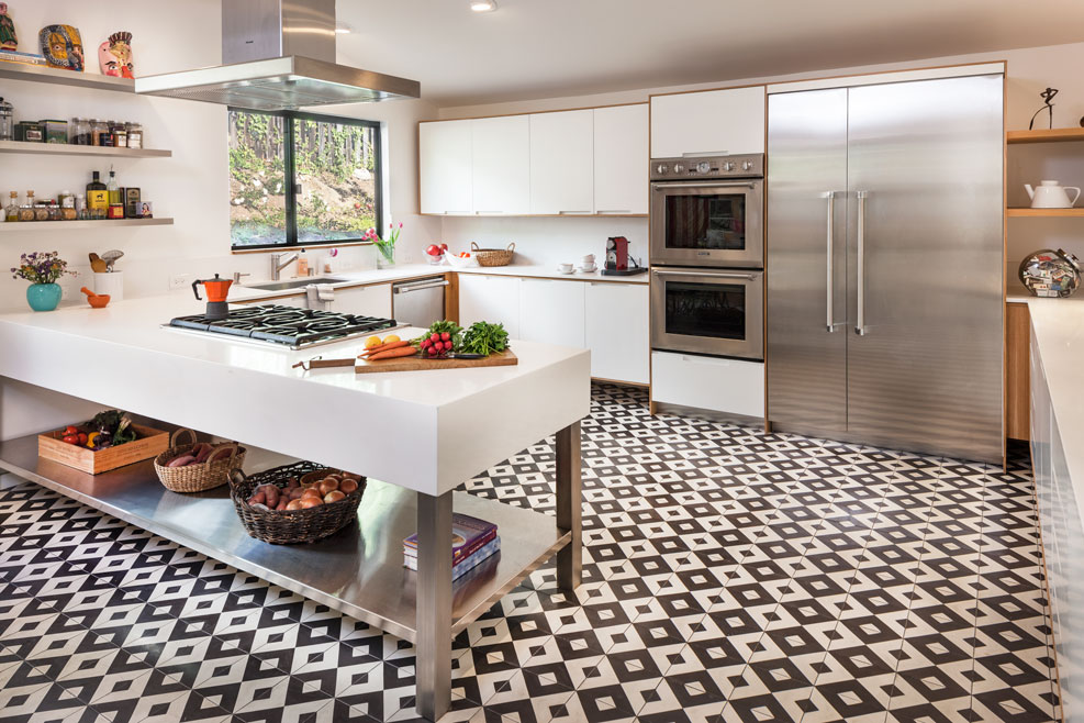 Bright and airy kitchen floored completely in geometric pattern