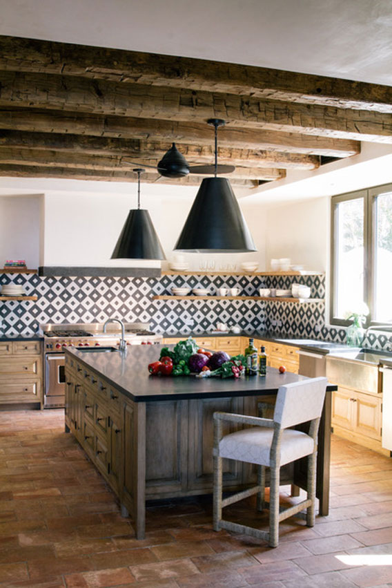 Big open hacienda kitchen with wide backsplash in black and white geometric pattern